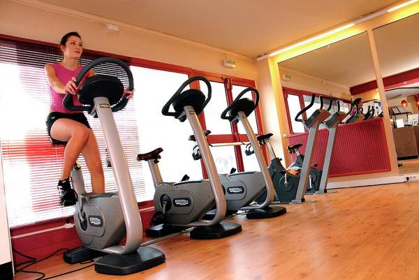 Physical Training Wall Art - Photograph - Woman Using An Exercise Bike by Aj Photo/science Photo Library