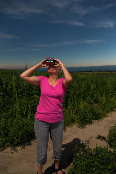 Totality Photograph - Woman Watching Total Solar Eclipse by Jim West/science Photo Library