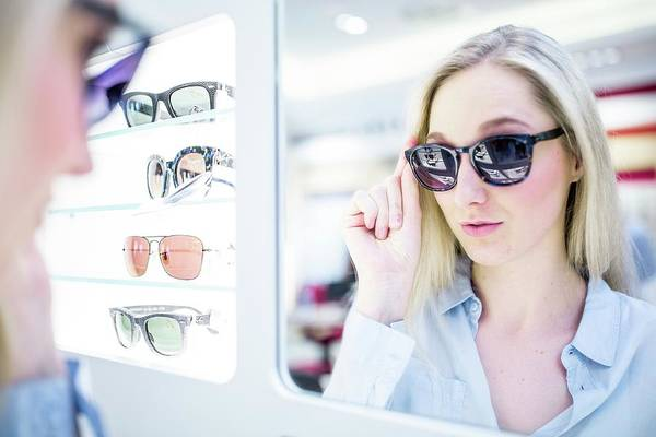 Apply Photograph - Woman Wearing Sunglasses by Science Photo Library