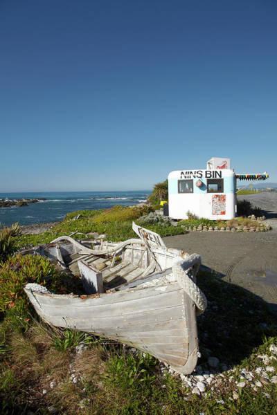 Caravan Photograph - Wooden Dinghy, And Nins Bin Lobster by David Wall