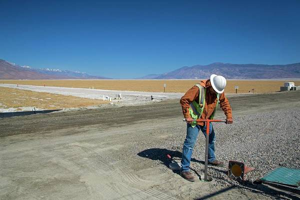 Bore Hole Wall Art - Photograph - Worker Digging A Bore Hole by Jim West