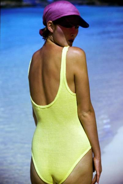 Swimsuit Photograph - Yasmine Sokal Wearing A Yellow Swimsuit by Arthur Elgort