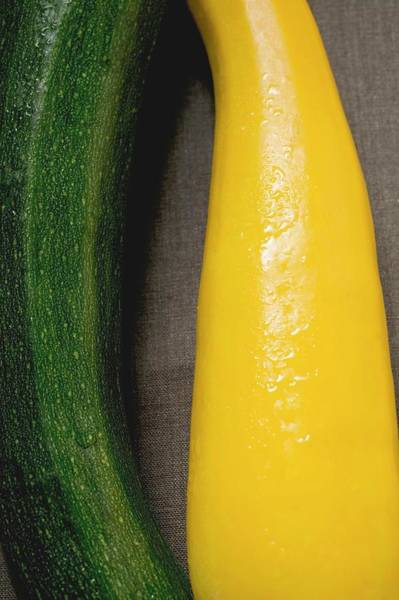 Cucurbit Photograph - Yellow And Green Courgettes On Brown Fabric Background by Foodcollection