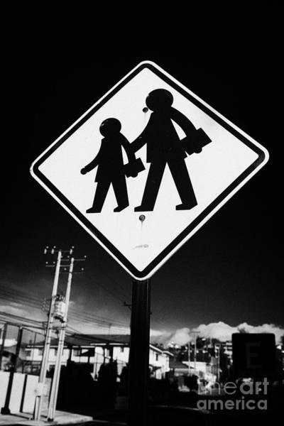 Wall Art - Photograph - yellow diamond road traffic warning sign of children crossing near school Punta Arenas Chile by Joe Fox