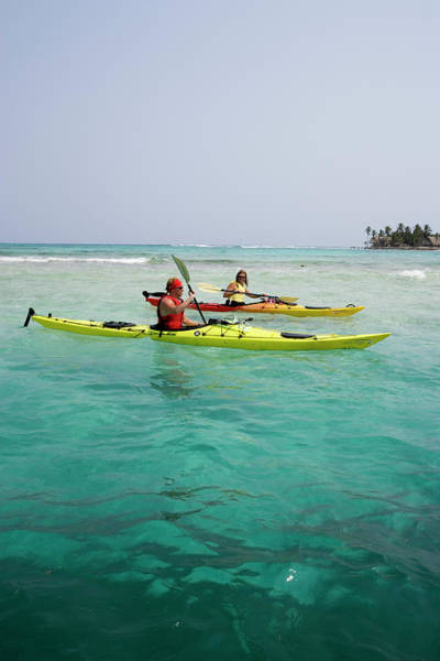 All Together Photograph - Young Couple Sea Kayaking by Henry Georgi