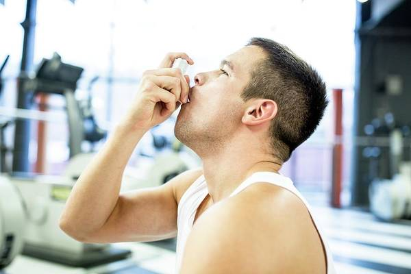 Wall Art - Photograph - Young Man Using Inhaler by Science Photo Library
