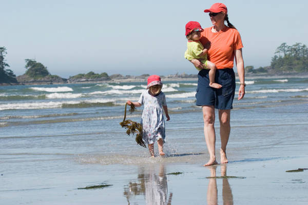All Together Photograph - Young Mother Walks Along Beach by Henry Georgi