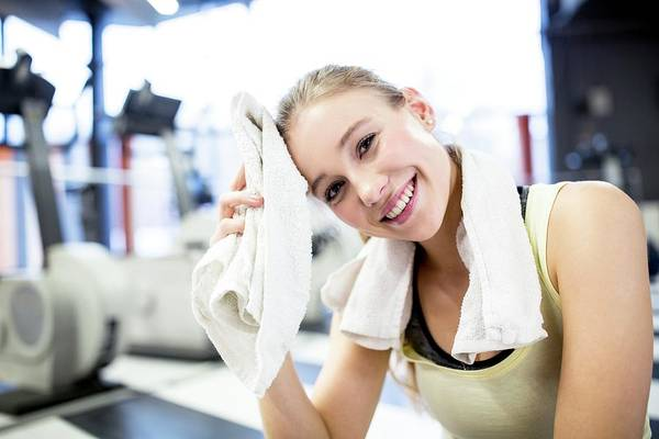 Self Confidence Photograph - Young Woman Wiping Her Sweat With Towel by Science Photo Library