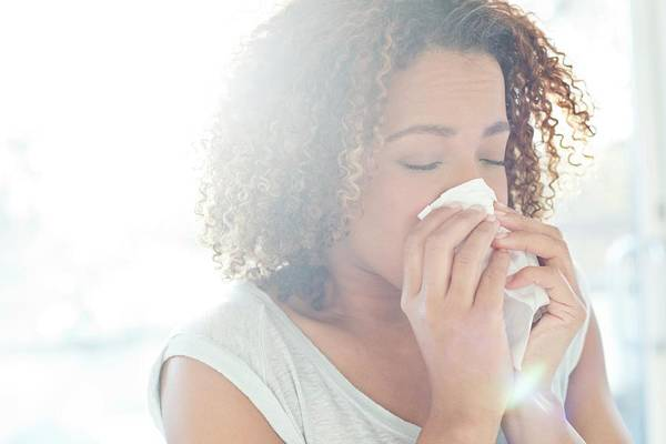 Wall Art - Photograph - Woman Blowing Nose On Tissue by Science Photo Library
