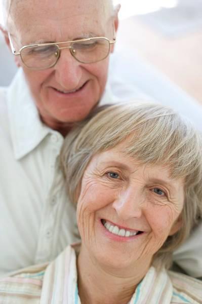 Cuddle Photograph - Senior Couple by Ian Hooton/science Photo Library