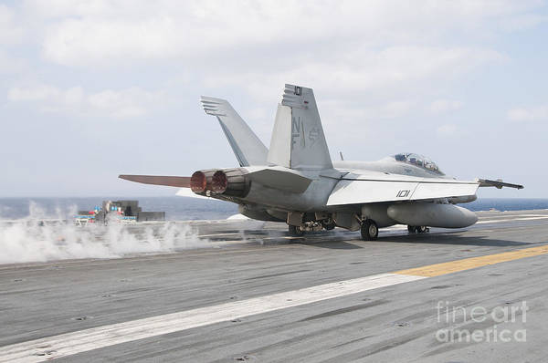 Uss George Washington Wall Art - Photograph - An Fa-18f Super Hornet Launches by Stocktrek Images