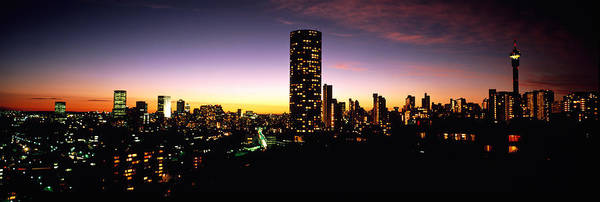 Johannesburg Wall Art - Photograph - Buildings In A City Lit Up At Night by Panoramic Images