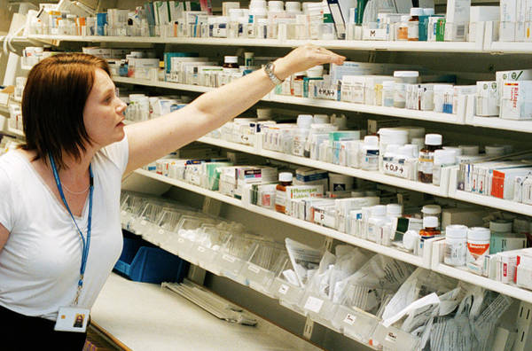 Package Wall Art - Photograph - Pharmacist by Mark Thomas/science Photo Library