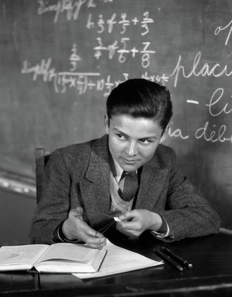 Sly Photograph - 1920s 1930s Boy At Desk In Classroom by Vintage Images