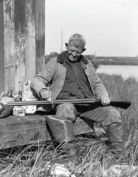 Duck Hunt Photograph - 1920s 1930s Senior Man Sitting On Bench by Animal Images