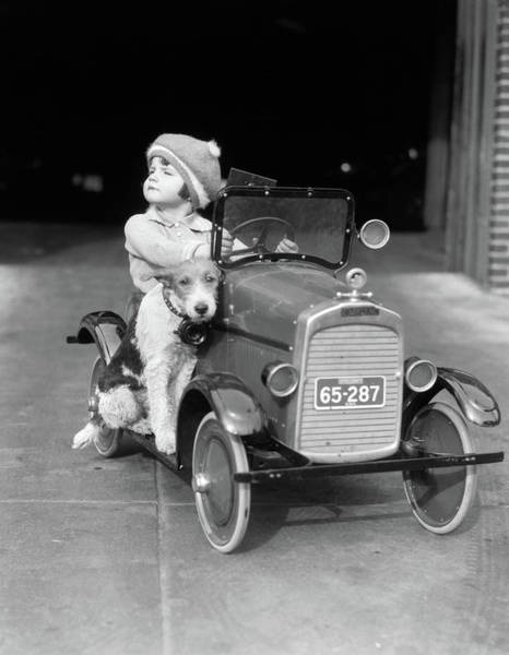 Pedal Car Wall Art - Photograph - 1920s Girl In Toy Pedal Car With Dog by Vintage Images