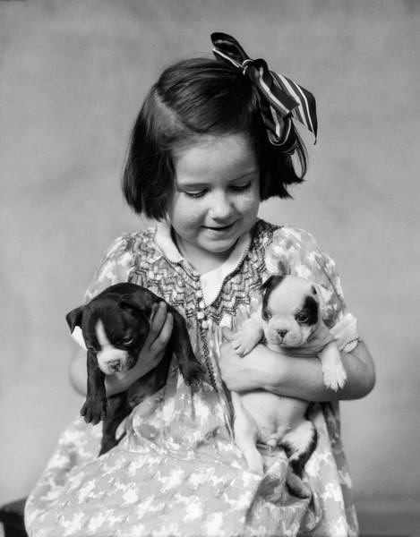 Pet Care Photograph - 1920s Little Girl Holding Two Boston by Vintage Images
