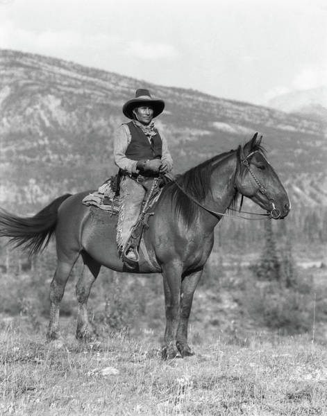 Stoney Photograph - 1920s Native American Man On Horseback by Animal Images