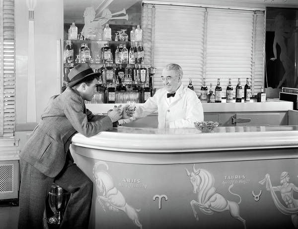 Cocktail Lounge Photograph - 1930s 1940s 1950s Man Leaning On Bar by Vintage Images