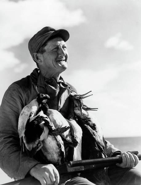 Duck Hunt Photograph - 1930s 1940s Portrait Senior Man Holding by Animal Images