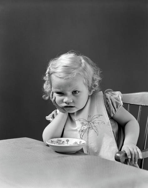 Disgusting Photograph - 1930s 1940s Sad Baby Girl At Table by Vintage Images