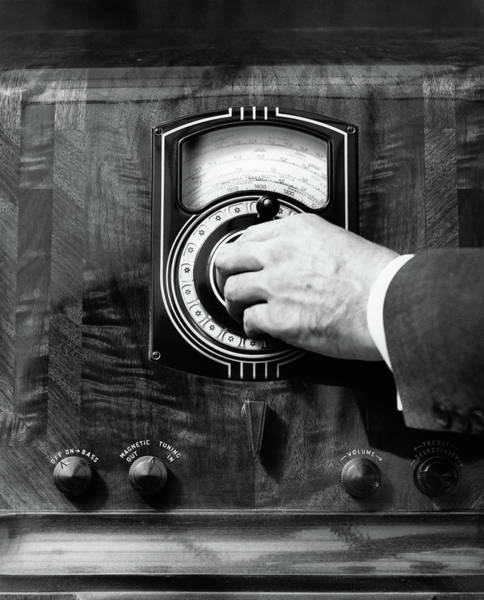 New Wave Music Photograph - 1930s Close Up Mans Hand Turning Radio by Vintage Images