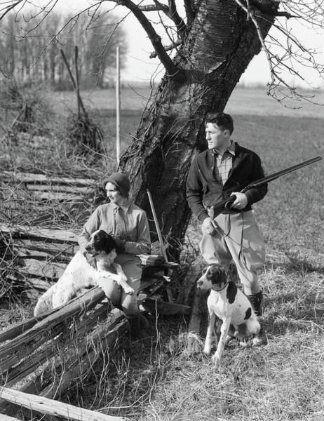 Springer Spaniel Photograph - 1930s Couple In Hunting Gear With Two by Animal Images