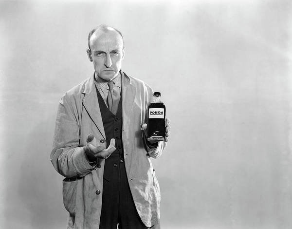Dour Photograph - 1930s Dour Man In Lab Coat Holding by Vintage Images