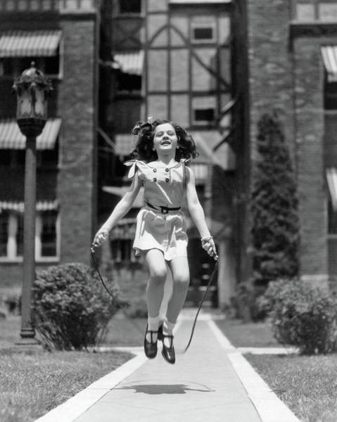 Esteem Photograph - 1930s Girl Jumping Rope On Sidewalk by Vintage Images