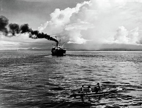 Outrigger Canoe Photograph - 1930s Group Of Natives In Outrigger by Vintage Images