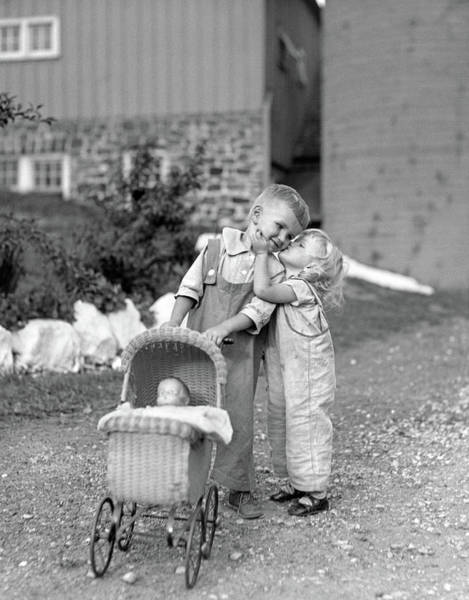 Little Person Wall Art - Photograph - 1930s Little Girl Kissing Boy Pushing by Vintage Images