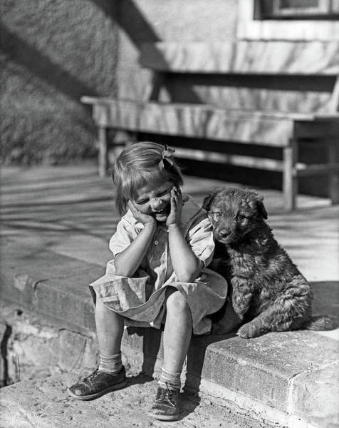 Puppies Photograph - 1930s Little Girl Sitting On Porch by Vintage Images