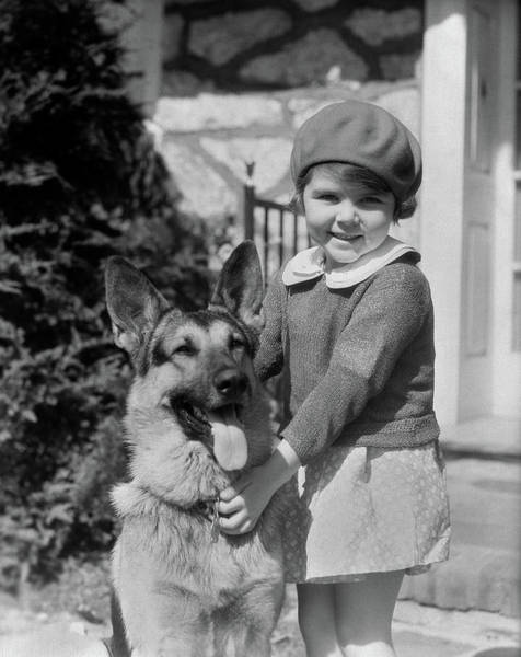 Wall Art - Photograph - 1930s Little Girl Standing Holding by Animal Images