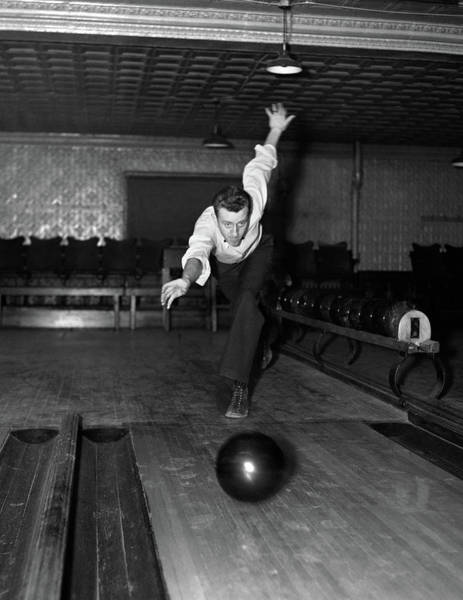 Bowling Alley Photograph - 1930s Man Bowling Just Releasing Ball by Vintage Images