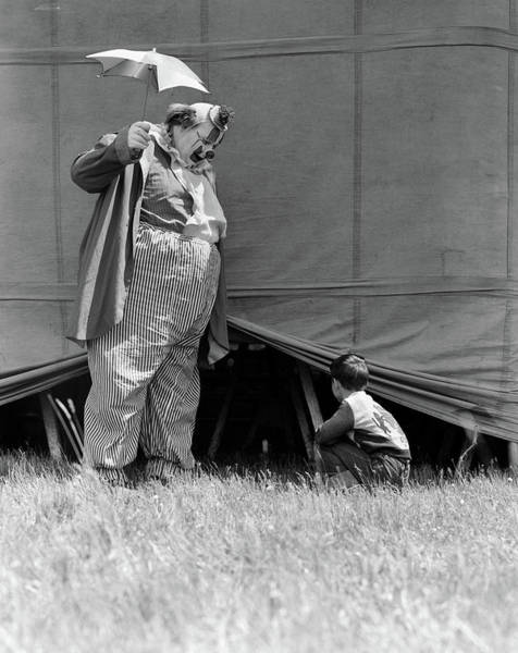 Big Boy Photograph - 1930s Man Clown Catching Little Boy by Vintage Images