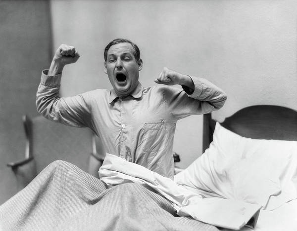 Yawn Photograph - 1930s Man In Bed Waking Up Yawning by Vintage Images