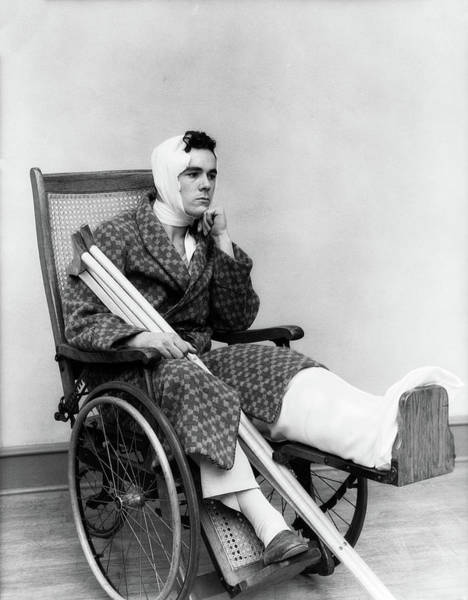 Heal Photograph - 1930s Man In Wheelchair Leg Cast by Vintage Images