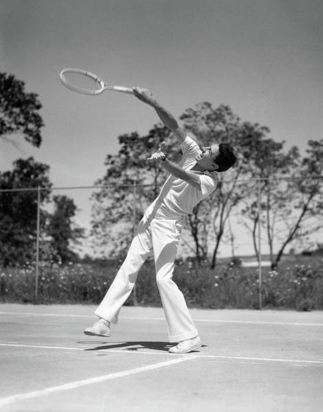 Esteem Photograph - 1930s Man Playing Tennis Swinging Racket by Vintage Images