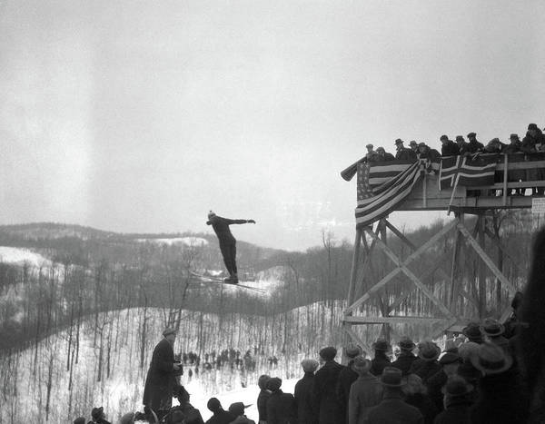 Ski Jumping Photograph - 1930s Man Ski Jumping In Mid Air Crowd by Vintage Images