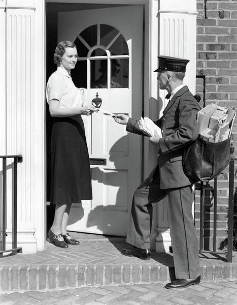 Wall Art - Photograph - 1930s Postman Giving A Letter by Vintage Images
