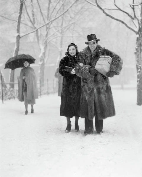 Raccoon Photograph - 1930s Smiling Christmas Shopping Couple by Vintage Images
