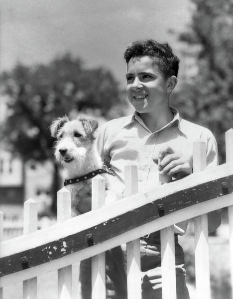 Fox Terrier Wall Art - Photograph - 1930s Teen Boy Smiling Standing by Animal Images