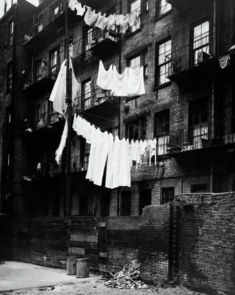 Tenement Photograph - 1930s Tenement Building With Laundry by Vintage Images