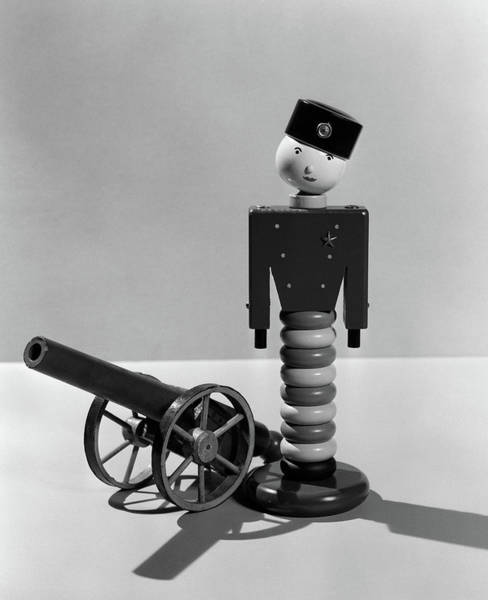 Space Gun Photograph - 1930s Wooden Toy Soldier Next To Cannon by Vintage Images