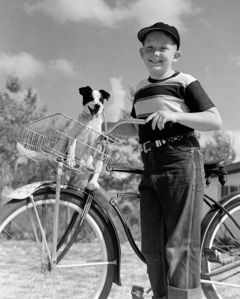 Pet Care Photograph - 1940s 1950s Boy On Bike With Puppy by Vintage Images