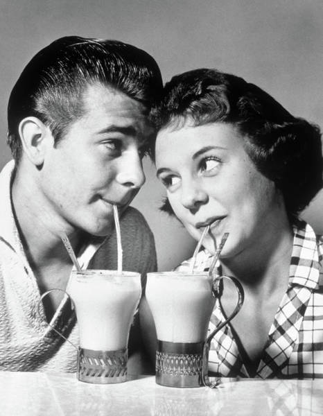 Milk Shake Photograph - 1940s 1950s Romantic Teenage Couple Boy by Vintage Images