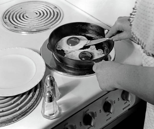 Sunny Side Up Wall Art - Photograph - 1940s 1950s Woman Hands Frying Eggs by Vintage Images