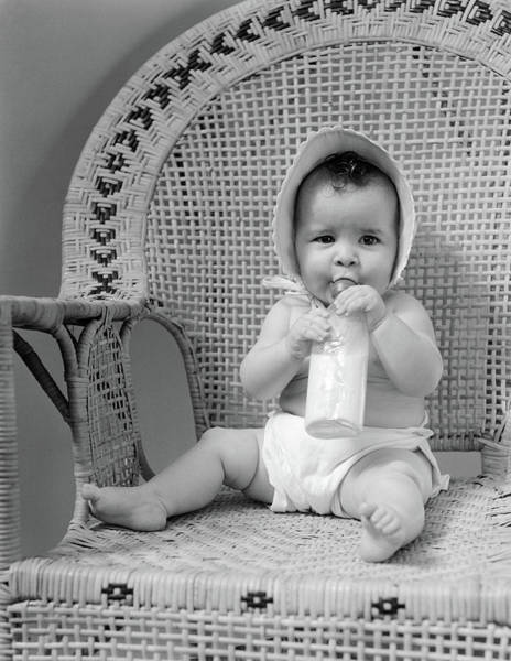 Wicker Chair Photograph - 1940s Baby Sitting In Wicker Chair by Vintage Images