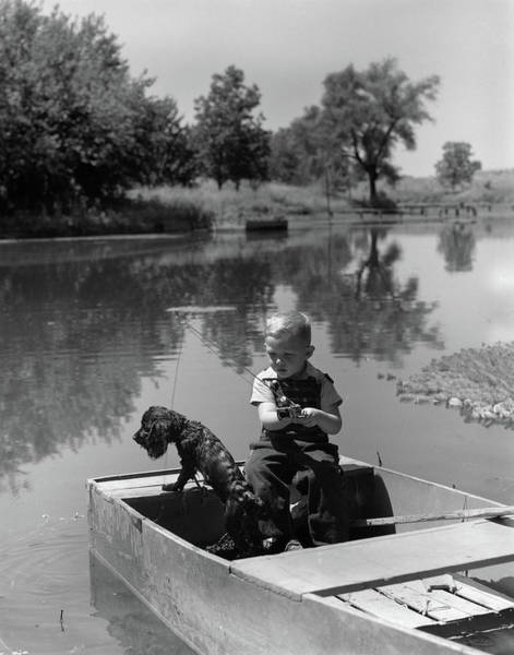 Cocker Spaniel Photograph - 1940s Boy With A Black Cocker Spaniel by Animal Images