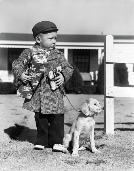 Puppies Photograph - 1940s Boy With Puppy On Leash Holding by Vintage Images